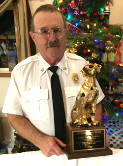 Chief Steve Avgeris with the Golden Sparky Award, given by the Oregon Sttate Fire Marshal's Office October 2020 (photo taken in Dec.)